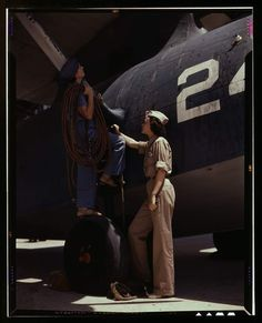 (Courtesy  |  Library of Congress) Cora Ann Bowen, left, works as a cowler with senior supervisor Eloise J. Ellis in the Assembly and Repairs department at the Naval Air Base in Corpus Christi, Texas. Aug. 1942.