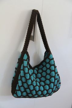 Hand Knit Purse with Magnetic Snap // Hobo Bag // Blue and Brown Shoulder Bag in Honeycomb Pattern. via Etsy.