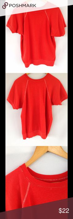 Vintage 70's Men's Short Sleeve Orange Sweatshirt Super cool vintage short sleeve sweatshirt from the 70's era. Orange-ish red color. Has a couple flaws as shown in close ups. Slight marking and a few missed stitches. Overall great condition. Vintage Shirts