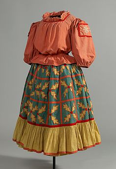 Natalia GONCHAROVA (designer Russia 1881 – France 1962), Barbara KARINSKA (costumier Russia 1886 – United States of America 1983), Costume for a nursemaid to King Dodon, c.1937.  Blouse: cotton; skirt: cotton, wool, metal, linen.
