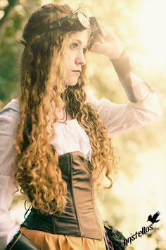 steampunk... again. I love her hair though, and the romantic lighting.