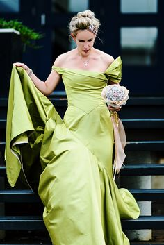 Gorgeous green wedding dress... love the asymmetrical shoulders!
