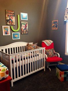 """Superhero Nursery- repainted and recovered glider; ottoman, bedding, and crib from Target; large wooden comic strip art from Hobby Lobby and Ross; framed printable """"Pow"""" and """"zap"""" free printables mounted on wrapping paper and framed; vintage superhero fabric for pillows purchased at JoAnn's"""