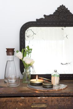 Add a hand carved centerpiece to a plain mirror to recreate a similar effect to this old mirror. Find a range of centerpieces, all made from real wood and carved by hand, at www.buycarvings.com