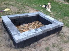 My days project was a DIY fire pit in the back yard. Grand total was $52. Pretty simple, took alot of sweat but got it done in around 5 hours. I think if i did it over again i would make it a little smaller, but hey if I ever want to spit roast a pig I can :)     Dig a hole, tamp, fill with sand, tamp, place cinder blocks, level up, paint with high temp paint, add stones and your done. And you can see its Marley approved.  #firepit