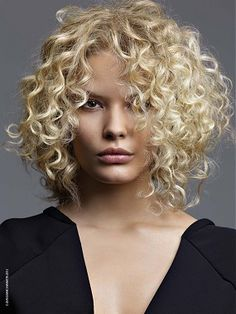 A long blonde curly coloured hairstyle by Jean-Marc Maniatis