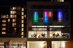Below the glow of multi-colored lights, students are seen studying at the Student Activity Center.