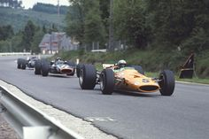 Belgian GP at Spa, 1968: Bruce McLaren scores his team's first F1 victory. Pedro Rodriguez (just behind McLaren in this photo) in the BRM finished second. It was the first F1 race in which wings were used. Chris Amon's Ferrari had a rear wing and qualified 4 seconds faster than Jackie Stewart's wingless Matra-Ford.