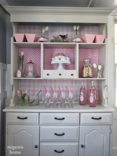 Great Hutch Makeover: Cover the back of a hutch with scrapbook paper that can be easily interchanged depending on the event!