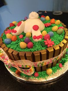 """Easter bunny Kitkat cake.  Can try this with chocolate frosting and the """"grass tip"""" for the green frosting....just need to buy candy eggs then!"""