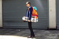 Street image by streetfsn, skateboard commuter complete with tailored jacket and oversized backpack