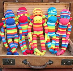 Hand Made Sock Monkeys If only I could find perfect socks like this !!!! Coco needs a rainbow cousin!!!