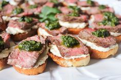 These heavenly beef tenderloin crostini with tangy goat cheese and pesto are a simple, yet deceptively impressive choice for entertaining.