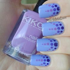 Light blue nails with navy blue, light & dark purple polka dots design at the moon, free hand nail art
