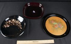 SQUARE-SHAPED LAQUER BOWL WITH MOTHER-OF-PEARL INLAY - BLACK LAQUER PLATE WITH BRUSHED GOLD LEAVES AND FLOWER ACCENTS - BLACK LAQUER PLATE WITH 2 BIRDS AND GOLD ON THE INSIDE.