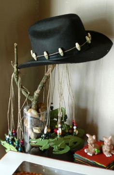 """Austrailian Outback Theme for Cooper's 1st Bday - Alligator Necklaces for the kids and his """"Crocodile Tooth"""" hat - made with beads and string."""
