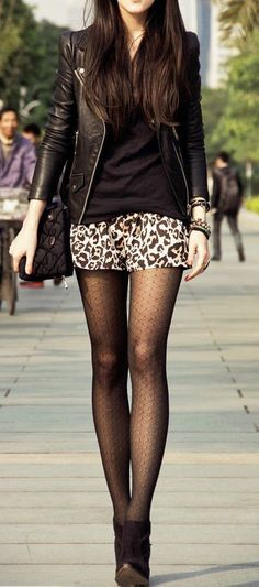 Street fashion tights, printed shorts and leather coat.