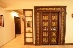 Pooja room with door containing embossed images of gods and goddesses in this Chettinad style home. Tanjore paintings on the wall. Pooja Room Design, House Design, Door Design, Pooja Rooms, Temple Design For Home, Room Doors, Room Door Design, Tv Room Design, Pooja Room Door Design