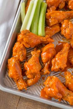 The BEST Buffalo Wings you'll and they're oven baked! Tossed with a deli… The BEST Buffalo Wings you'll and they're oven baked! Tossed with a delicious buffalo wing sauce these will be the hit of your parties! Baked Curry Chicken, Honey Garlic Chicken Wings, Chicken Wing Sauces, Baked Chicken Wings, Chicken Wing Recipes, Thai Chicken, Peanut Chicken, Crispy Chicken, Teriyaki Chicken
