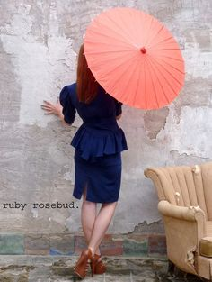 Get this gorgeous vintage dress at a Ruby Rosebud on Etsy. Here: http://www.etsy.com/listing/82059732/vintage-navy-peplum-dress #vintage #navydress #redumbrella photo by me