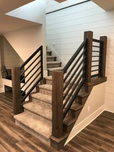 Faux barn beams with metal railing. Staircase Remodel, Staircase Makeover, Basement Makeover, Interior Stair Railing, Stair Railing Design, Stair Banister, Banisters, House Stairs, Basement Stairs