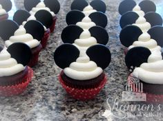 Mickey Mouse theme cupcakes. Red velvet cake with vanilla buttercream and homemade cocoa marshmallow fondant ears.