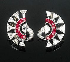 An Pair of Elegant Art Deco Ruby and Diamond Ear Clips  Each of openwork design, the outer spray of trapeze and baguette-cut diamonds with calibr-cut ruby detail to the half-moon and circular-cut diamond stem, circa 1930, ear clip fitting engraved with patent date Nov. 15th, 1927. Bijoux Art Deco, Art Deco Earrings, Art Deco Jewelry, Ruby Jewelry, Fine Jewelry, Art Quotidien, Antique Jewelry, Vintage Jewelry, Diamond Earing
