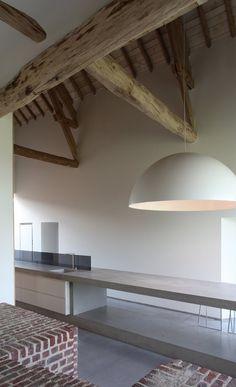 The Rabbit hole, Gaasbeek, 2010  by LENS°ASS architecten #architecture #archilovers #interiors #design #kitchens Het moderne en strakke interieur wordt versterkt door een moderne lamp toe te voegen. Door het hout in het plafond en de bakstenen krijgt het interieur een warme toets