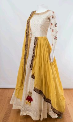 Like the white anarkali and yellow dupatta combo. Don't wanna get it sew though Indian Gowns Dresses, Indian Fashion Dresses, Dress Indian Style, Indian Designer Outfits, Indian Outfits, Fashion Outfits, Ivory Prom Dresses, Indian Fashion Trends, Indian Clothes