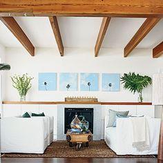 glam-great-room-exposed-beams-palm-prints - Beach Style Resort Glam Interiors - Coastal Living