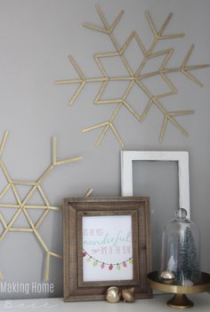 Printables are an inexpensive way to add seasonal updates that jibe with the rest of your home. This subtle Christmas vignette, for example, complements the homeowner's existing decor.