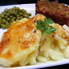 """Rich and Creamy Potatoes Au Gratin I """"Absolutely delicious and a great potato dish for special occasions. Do not be afraid of the nutmeg as it provides a unique flavor that will tickle your taste buds."""""""