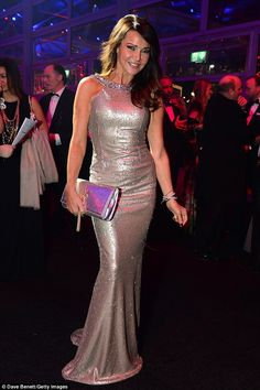 Dressed to impress: The TV presenter wore her brunette locks in glamorous waves at the sta...