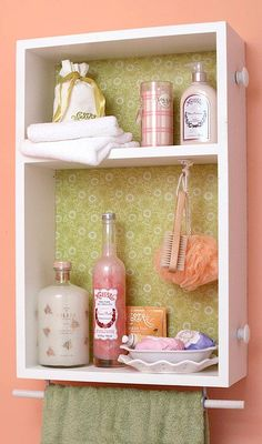 Take an old drawer - repaint it, decoupage the inside with scrapbook paper or fabric, hang it up! Add hooks for jewelry and use the handles on the side for necklaces