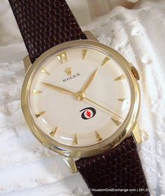 Very rare vintage 1960 14K Rolex Men's watch. 35mm Case. Company logo presentation watch of its day. Mint Condition