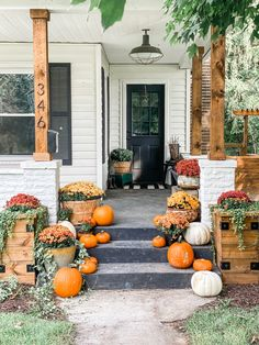 Easy fall porch decor with mums and pumpkins. Fall porch decorating. Fall porch. Patio Decorating Ideas On A Budget, Porch Decorating, Farmhouse Front Porches, Fall Front Porches, Rustic Farmhouse, Mums In Pumpkins, Porch Makeover, Exterior Makeover, Fall Planters