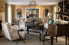 Contemporary and traditional styles expertly blend in this posh living room. A mostly neutral color palette helps unite the space, and metallic accents ensure it's anything but boring.