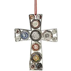 These beautiful cross ornaments are made by coiling recycled magazine pages. No two are alike and the image here only reflects the shape. We'd be happy to email a photo with options before shipping. W