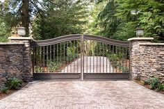 This gate is a true masterpiece! It was hand painted with faux petina to give it an aged, antique finish. Photo by Imaging Northwest Front Gate Design, Door Gate Design, Fence Design, Driveway Entrance Landscaping, Driveway Design, Wrought Iron Driveway Gates, Farm Entrance, Custom Gates, Farm Gate