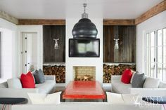In the family room, a metal light fixture that Douglass purchased in Belgium holds court over streamlined furnishings from South of Market.