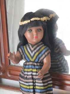 Celluloid doll Linda Carla. Doll with black mohair wig, original flirty eyes. Closed mouth and rosy cheeks.