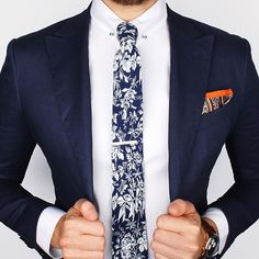 The Cobalt blue flower tie and Orange paisley ps over the new Herringbone collar-bar shirt What's your thoughts on this look? www.Grandfrank.com