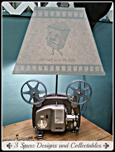 3 Spurz D&C Repurposed /Refurbished Creations!!: 18-5 Bolex Paillard 8 mm projector repurposed into lamp with custom lamp shade. Follow us for more wonderful pins at http://pinterest.com/3spurzdandc/... http://facebook.com/... http://www.3spurzdesignsandcollectables.com/about-us