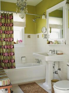Wake Up White  A vintage white bathroom gets an update with apple-green walls. Green is paired with pink and brown on the chic shower curtain. A crystal chandelier complements the vintage theme.