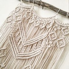 This hand-made macrame wall hanging is hand-made by Hanifah Tohir. It is a made-to-order piece and is perfect to hang for a boho feel in your bedroom, living room or your bathroom.  Measurement Length 38cm approx Height 78cm approx