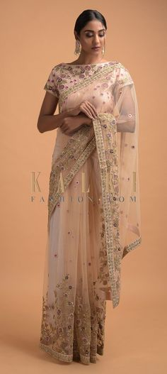 Buy Online from the link below. We ship worldwide (Free Shipping over US$100)  Click Anywhere to Tag Powder Peach Saree In Net Adorned With Resham And Zardozi Embroidered Floral Pattern Online - Kalki Fashion Powder peach saree in net adorned with resham, sequins, zardozi and zari embroidered floral pattern and buttis.Paired with a matching blouse in raw silk with similar floral embroidery.