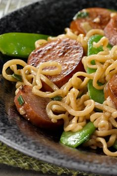 Sausage & Ramen Noodle Stir-Fry – This dorm-room classic is graduating. Ditch the seasoning packet, and create your own stir-fry recipe with garlic, snow peas, sesame dressing, and turkey sausage. Garlic Recipes, Stir Fry Recipes, Sausage Recipes, Asian Recipes, Cooking Recipes, Sausage Meals, Sausage Stir Fry, Sausage Rice, Mie Goreng