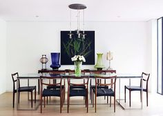 Modern dining space with monochromatic colors and flowers in the center of the table