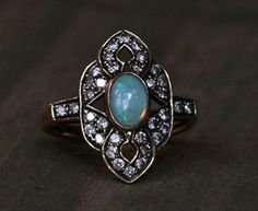 Edwardian Opal Engagement Ring. So different. Very pretty,