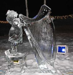 Ice Angel Playing Harp ice sculpture, taken at Christmas in Ice  - North Pole, Alaska.